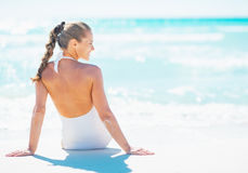 Woman sitting at seaside and looking on copy space Stock Photo