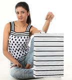 Woman sitting with shopping bag Royalty Free Stock Images