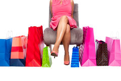 Woman sitting with Shopping bags Stock Photography