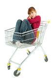 Woman sitting  in shopping cart Royalty Free Stock Photography