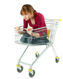 Woman sitting in shopping cart Stock Photography