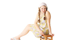 Woman sitting on small bench Royalty Free Stock Photos