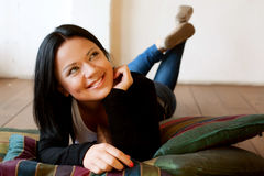 Woman sitting and  smiling indoors Royalty Free Stock Image