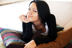 Woman sitting and  smiling indoors Royalty Free Stock Photo