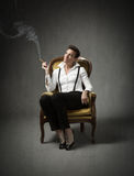 Woman sitting and smokes Royalty Free Stock Image