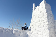 The woman sitting at snow fortress Royalty Free Stock Image