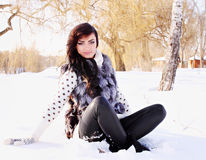 Woman sitting in the snow Stock Image