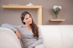 Woman sitting on the sofa Stock Photo