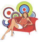 Woman sitting on sofa Stock Photo
