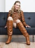 Woman sitting on sofa Stock Photography