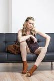 Woman sitting on sofa Stock Photo