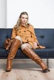 Woman sitting on sofa Royalty Free Stock Photos
