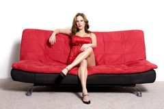 Woman sitting on sofa Stock Photos