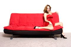 Woman sitting on sofa Royalty Free Stock Photos