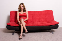 Woman sitting on sofa Royalty Free Stock Images