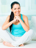 Woman sitting on the sofa Stock Image