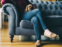 Woman Sitting on Sofa at Home Royalty Free Stock Images