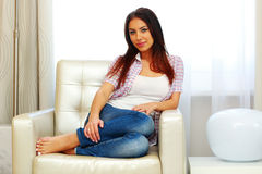 Woman sitting on the sofa at home Royalty Free Stock Photography