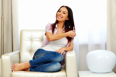 Woman sitting on the sofa at home Stock Images