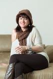 Woman sitting on sofa Royalty Free Stock Photo