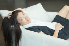 Woman sitting sofa. Stock Images