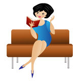 Woman sitting on a sofa reads a book Royalty Free Stock Photos