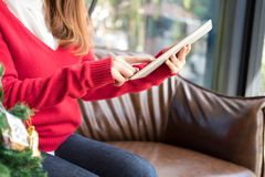 Woman sitting on sofa using tablet pc at home. girl texting mess Stock Images