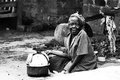 Woman Sitting on Soil Beside Cooking Pot Royalty Free Stock Image
