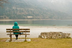 Woman sitting in solitude Royalty Free Stock Image
