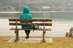 Woman sitting in solitude Royalty Free Stock Photography