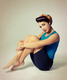 Woman sitting in sport clothes in retro style Stock Photo