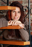 Woman sitting on stair Royalty Free Stock Photos
