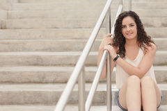 Woman sitting on a staircase Stock Photography