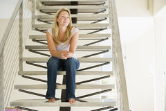 Woman sitting on stairs Stock Image