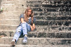 Woman sitting on stairs royalty free stock images