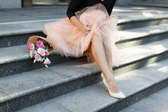 Woman sitting on the stairs with flowers Stock Image