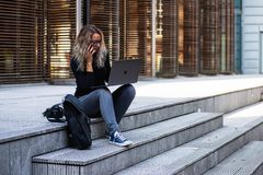 Woman Sitting on Stairs While Using Laptop stock photo
