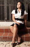 Woman sitting on steps Royalty Free Stock Photos