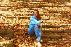 Woman sitting on steps Royalty Free Stock Image