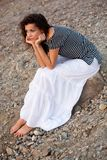 Woman sitting on the stone Royalty Free Stock Photo