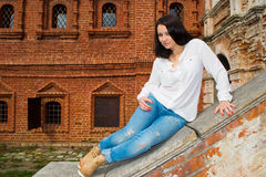 Woman sitting on stone staircase railing Stock Photos