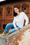 Woman sitting on stone staircase railing Stock Photography