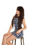 Woman sitting on stool blue dress Royalty Free Stock Images