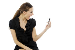 Woman sitting on a stool holding a cellphon Royalty Free Stock Photos