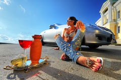 Woman sitting on the street Stock Photo