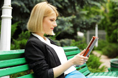 Woman sitting on the street bench Royalty Free Stock Images