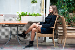 Woman sitting in street cafe Royalty Free Stock Photos