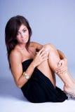 Woman sitting in studio Royalty Free Stock Image