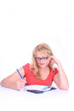 Woman, sitting , studying. Royalty Free Stock Image
