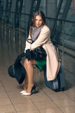 Woman sitting on suitcase Royalty Free Stock Images